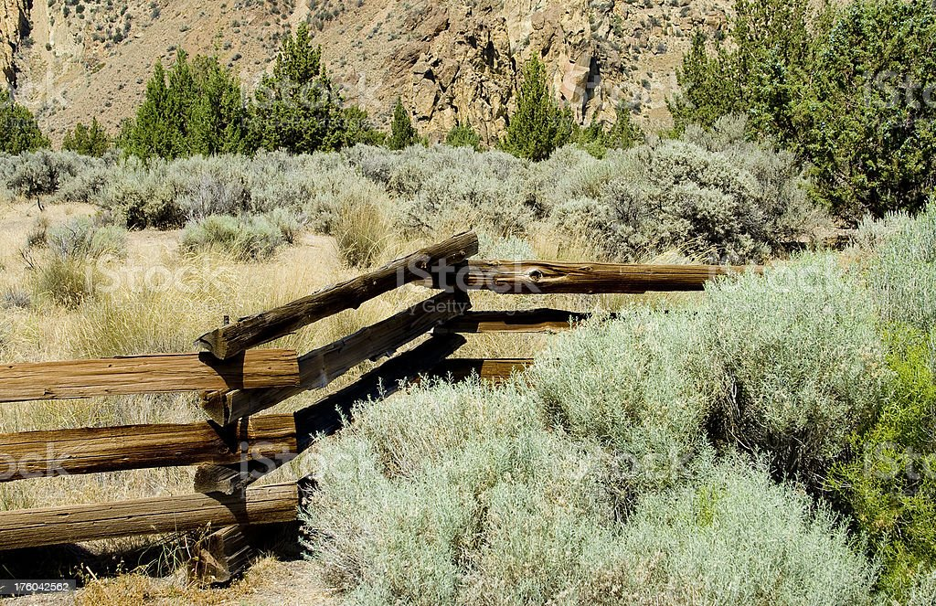 Wood fence in field of sage brush royalty-free stock photo