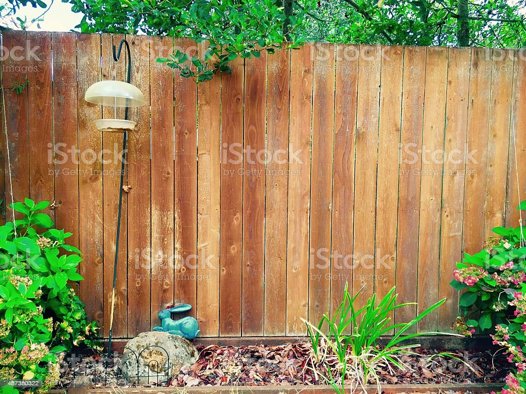 Wood fence in the backyard royalty-free stock photo