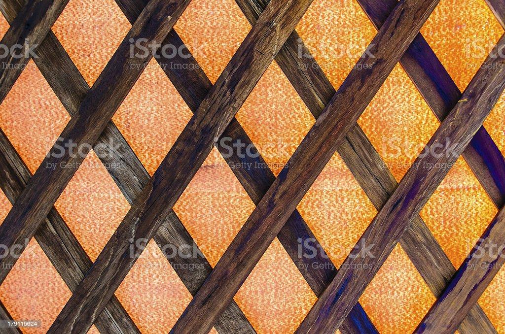 wood fence weave on orange background royalty-free stock photo