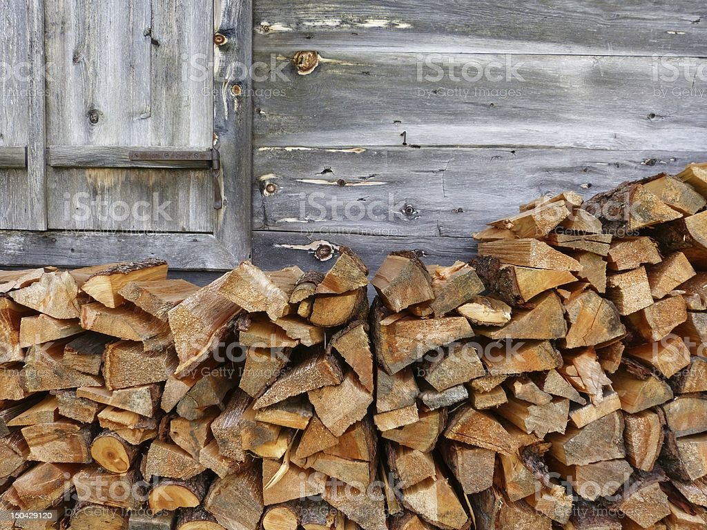 Wood fire to the wooden wall of a hut royalty-free stock photo