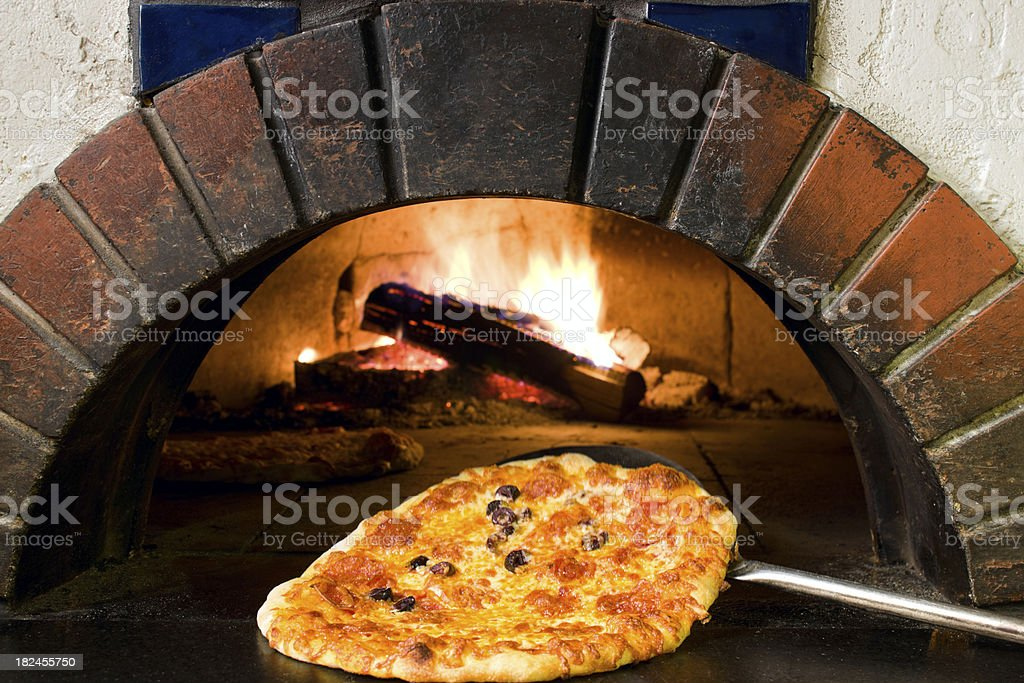 Wood fired oven and fresh pizza. stock photo