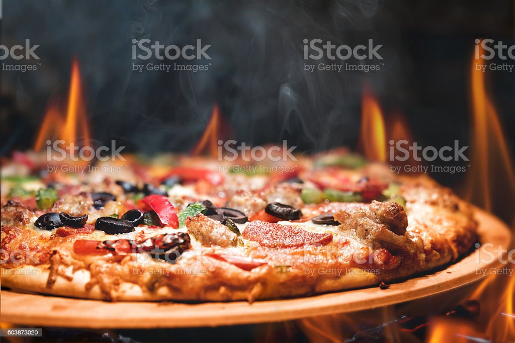 Wood Fired Pizza With Flames stock photo