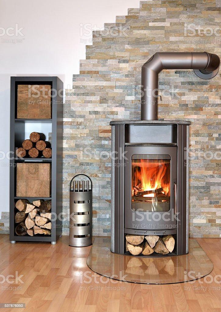 wood fired stove burning stock photo