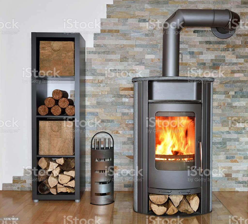 wood fired stove while burning stock photo
