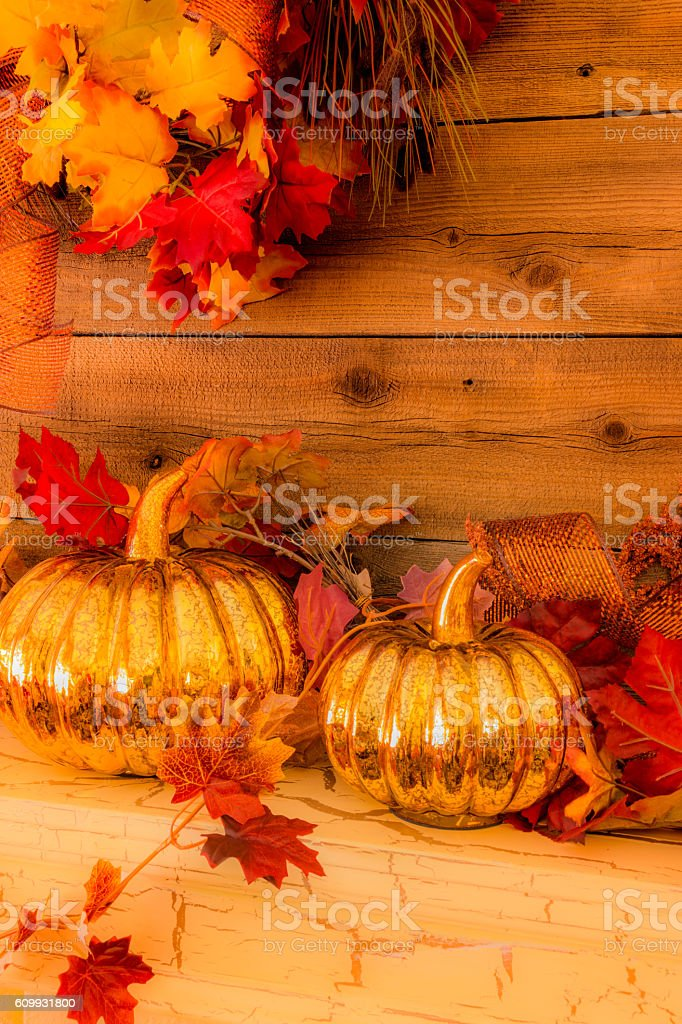 Wood fireplace mantelpiece with fall decorations and pumpkins (P) stock photo
