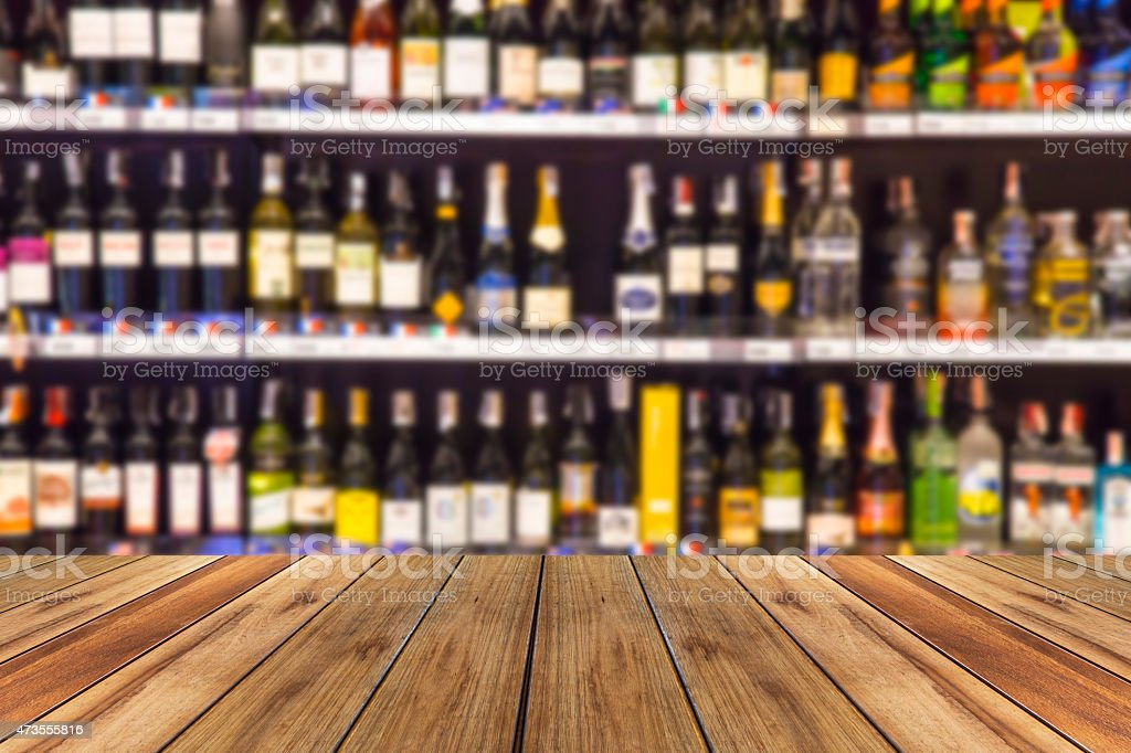 wood floor and wine Liquor bottle on shelf  Blurred background stock photo