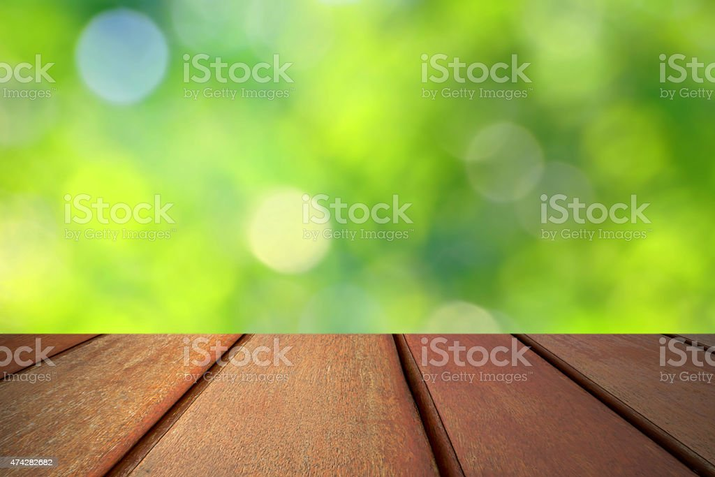 Wood floor top on green bokeh background royalty-free stock photo