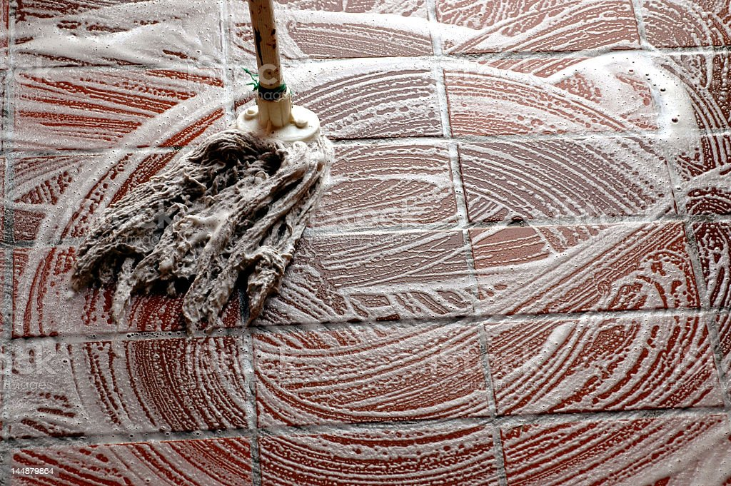 Wood flooring being mopped with soap stock photo