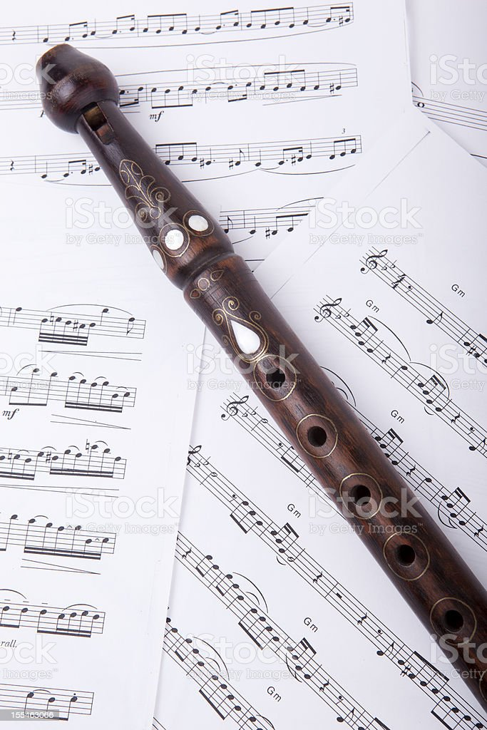 wood flute and sheet music royalty-free stock photo
