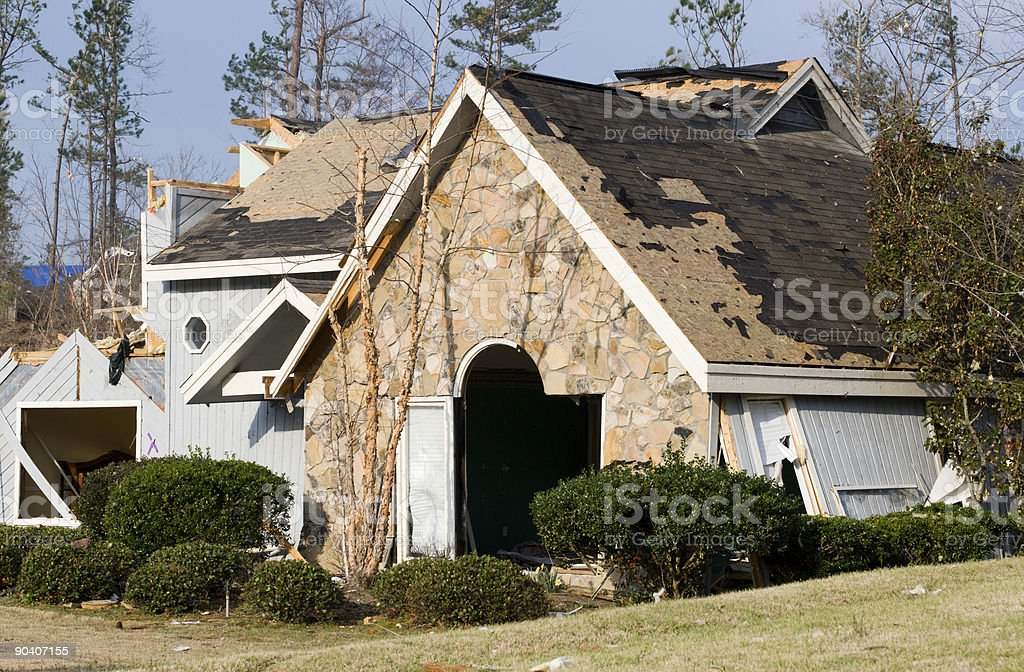 Wood frame and stone house destroyed by an EF2 tornado royalty-free stock photo