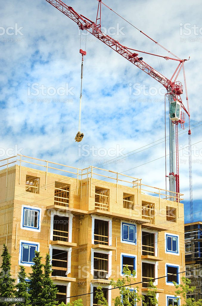 Wood Frame Construction Site with Tower Crane royalty-free stock photo