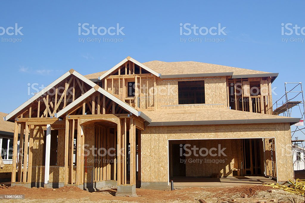 Wood frame of a new house under construction stock photo