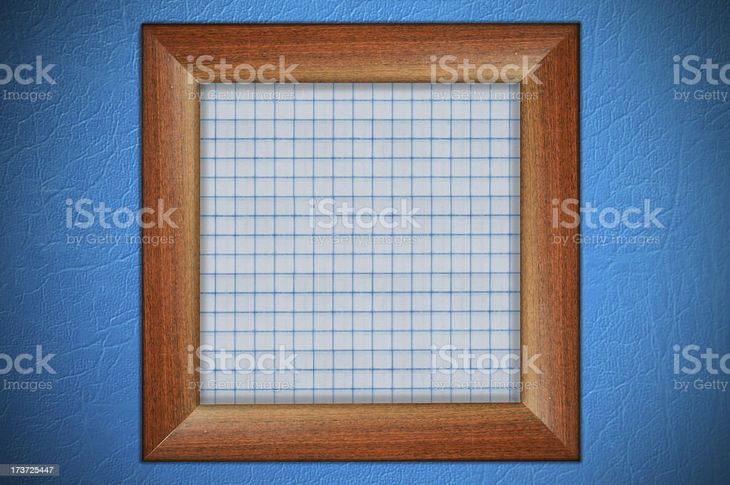 Wood frame with paper fill at blue wall stock photo