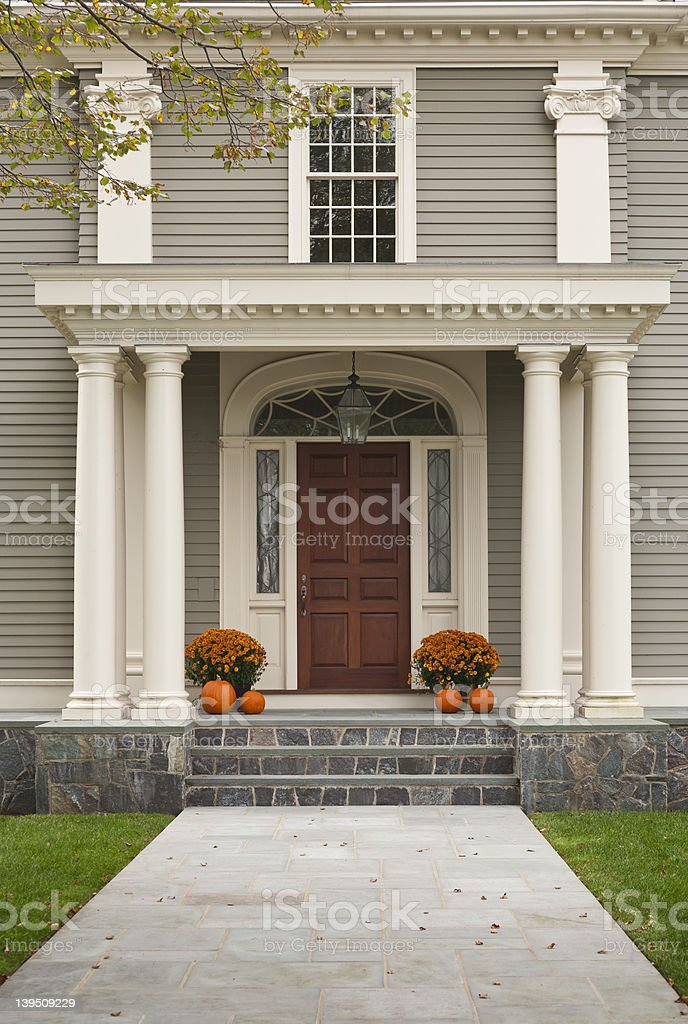 Wood Front Door and Entrance with Columns stock photo