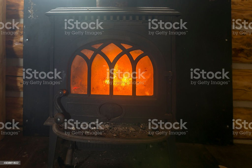 Wood Furnace in the cabin stock photo
