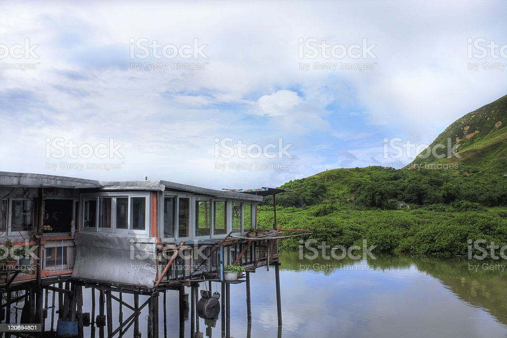 wood house on the water stock photo