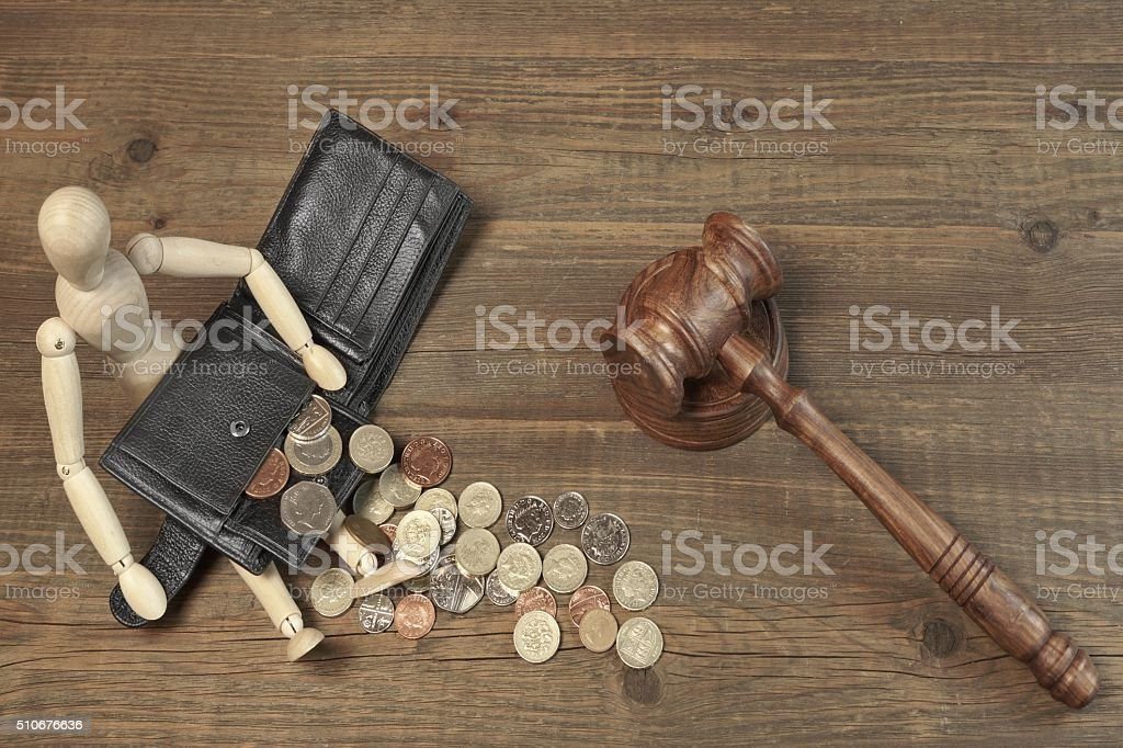 Wood Humane Figurine, Black Wallet With British Coins And Gavel stock photo