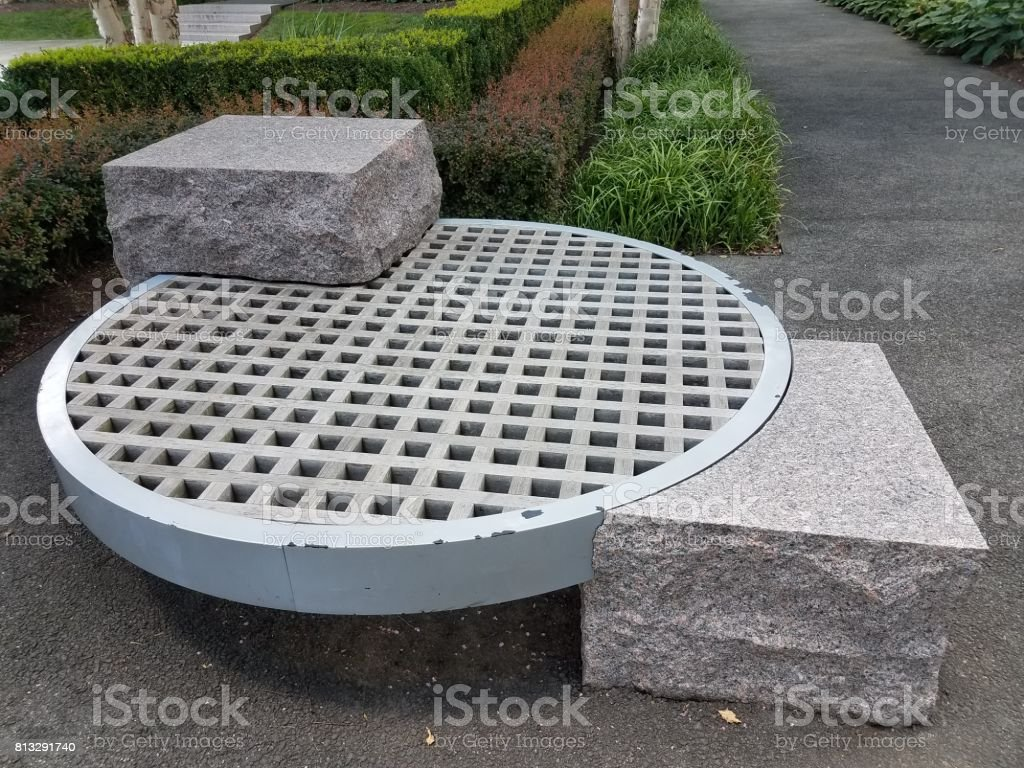 wood lattice bench and rocks stock photo