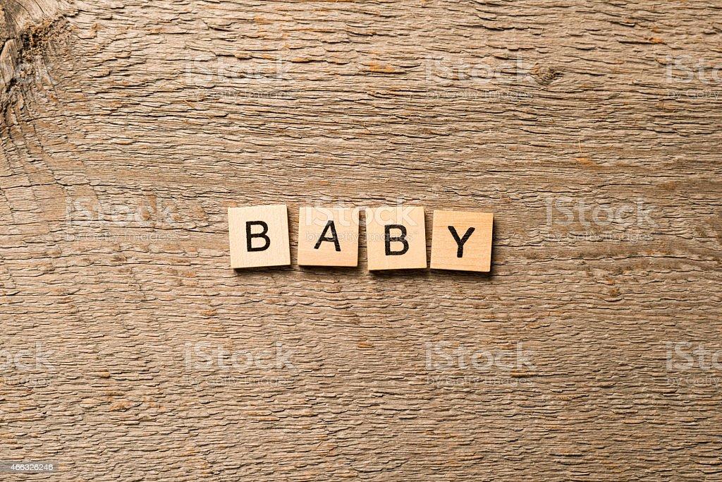 Wood letter tiles spelling baby stock photo