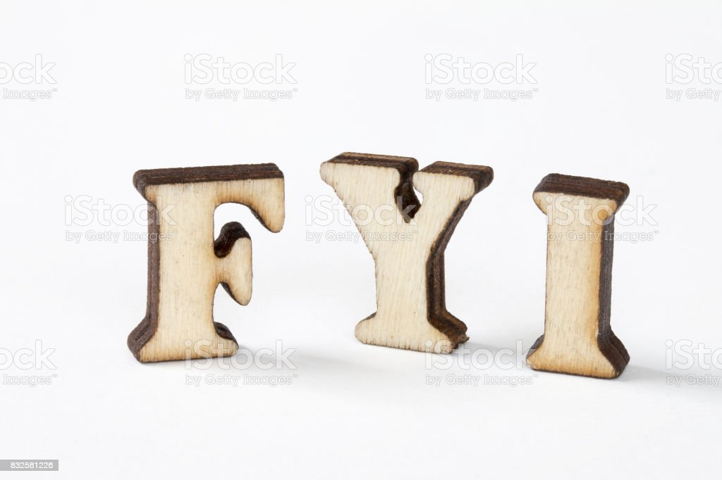 FYI, Wood letters FYI on White background,for your information stock photo