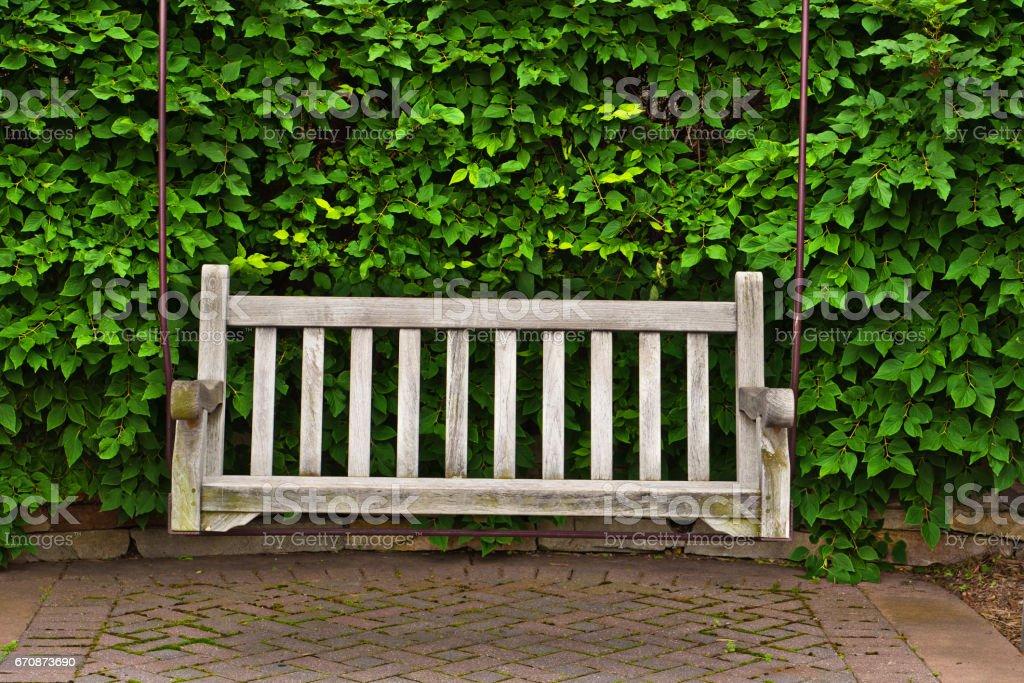 Wood Long Bench Outdoor Chair in Garden Patio stock photo