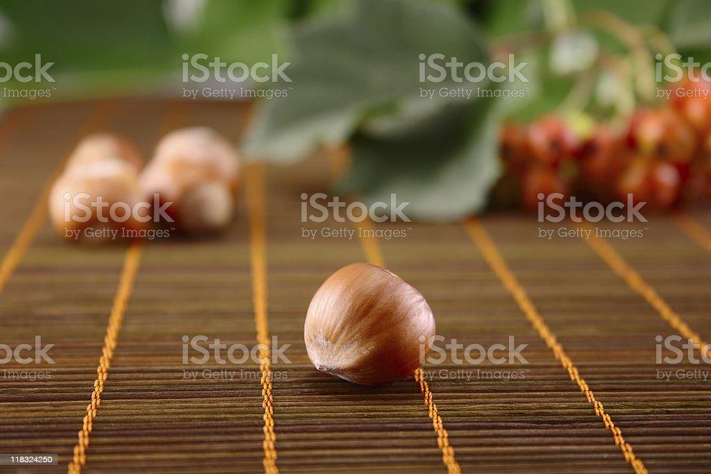 Wood nut on bamboo napkin royalty-free stock photo