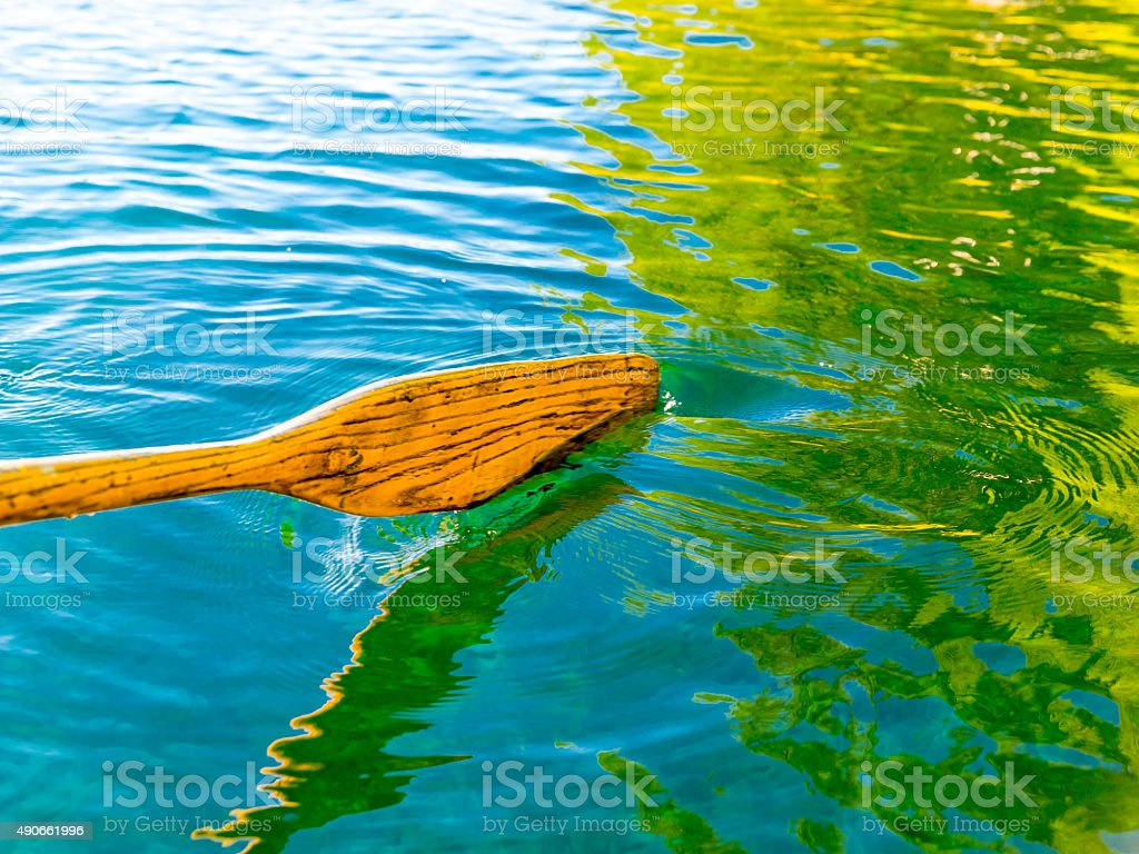 Wood Oar in Oregon Lake Blue Green Water from Reflections stock photo
