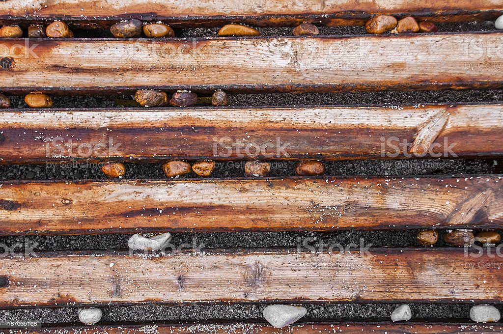 Wood, pebble and sand background royalty-free stock photo