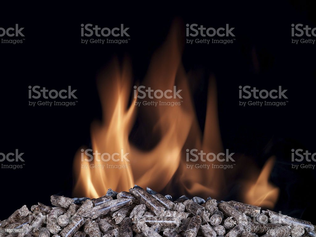 Wood pellets burning stock photo