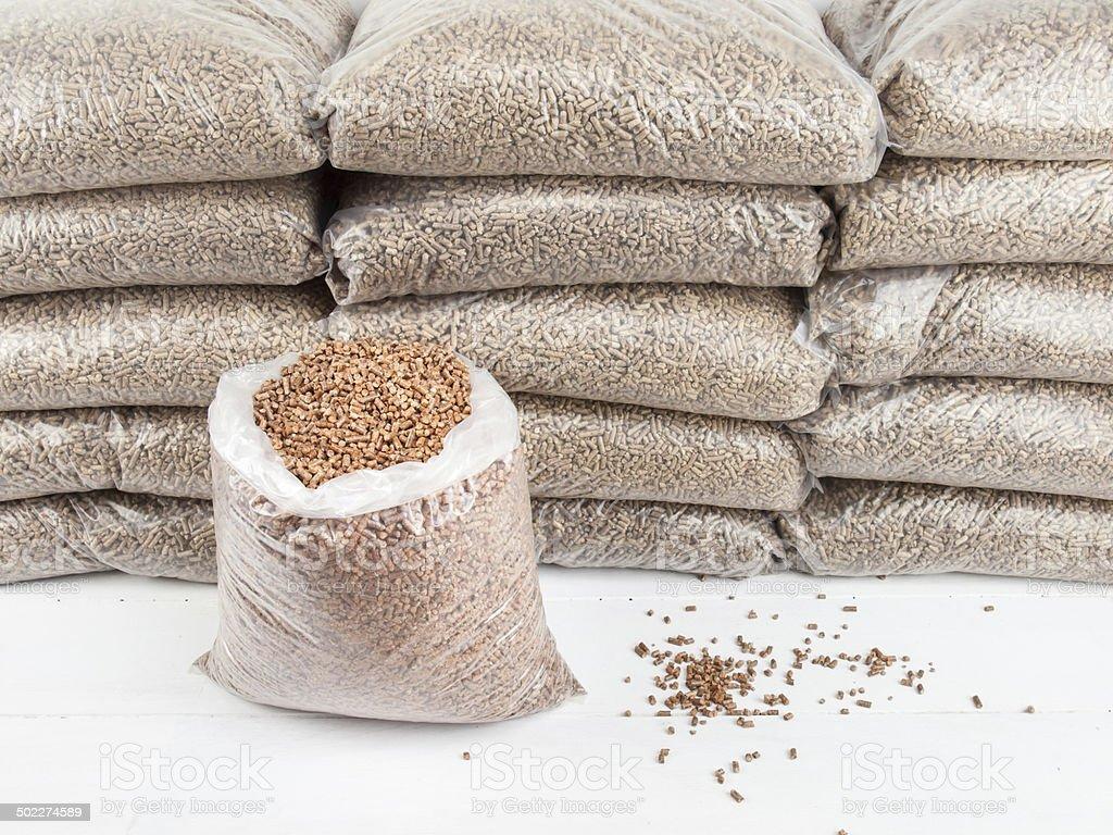 wood pellets in bags stock photo