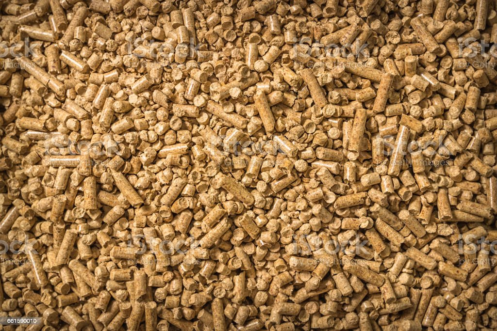 Wood pellets on the background. Biofuels. Cat litter. stock photo