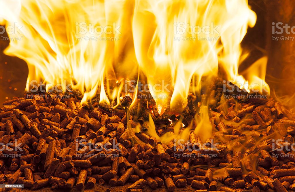 Wood pellets producing a roaring fire stock photo