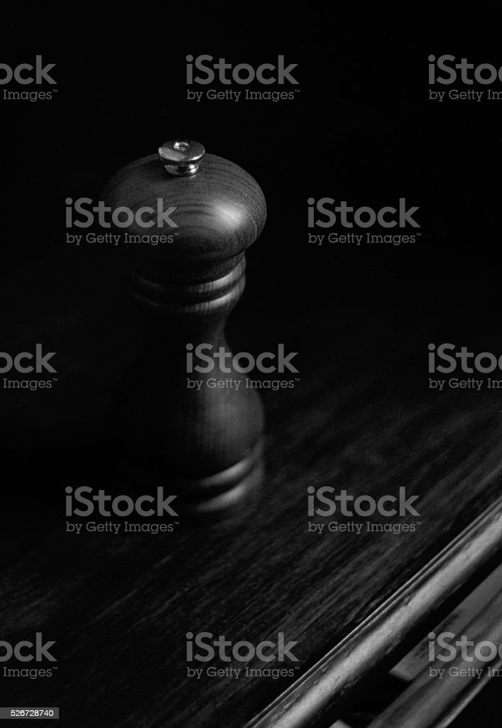 Wood Peppermill on a Wood Table stock photo