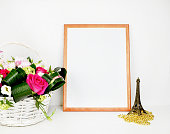 Wood picture frame with decorations. Mock up .Peonies in vase.