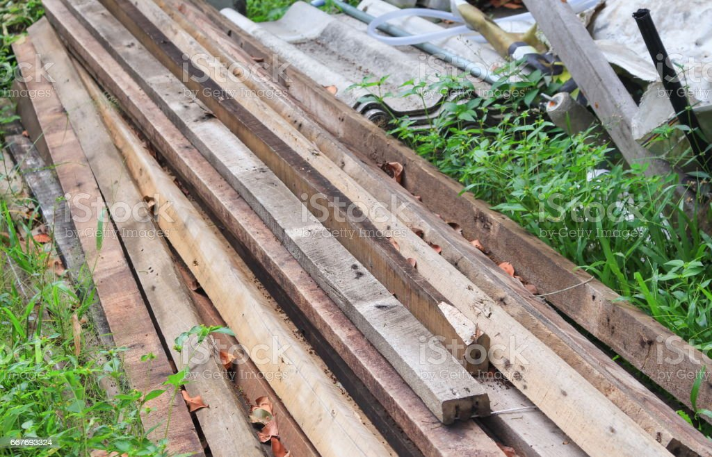 wood pile on the grass construction work stock photo