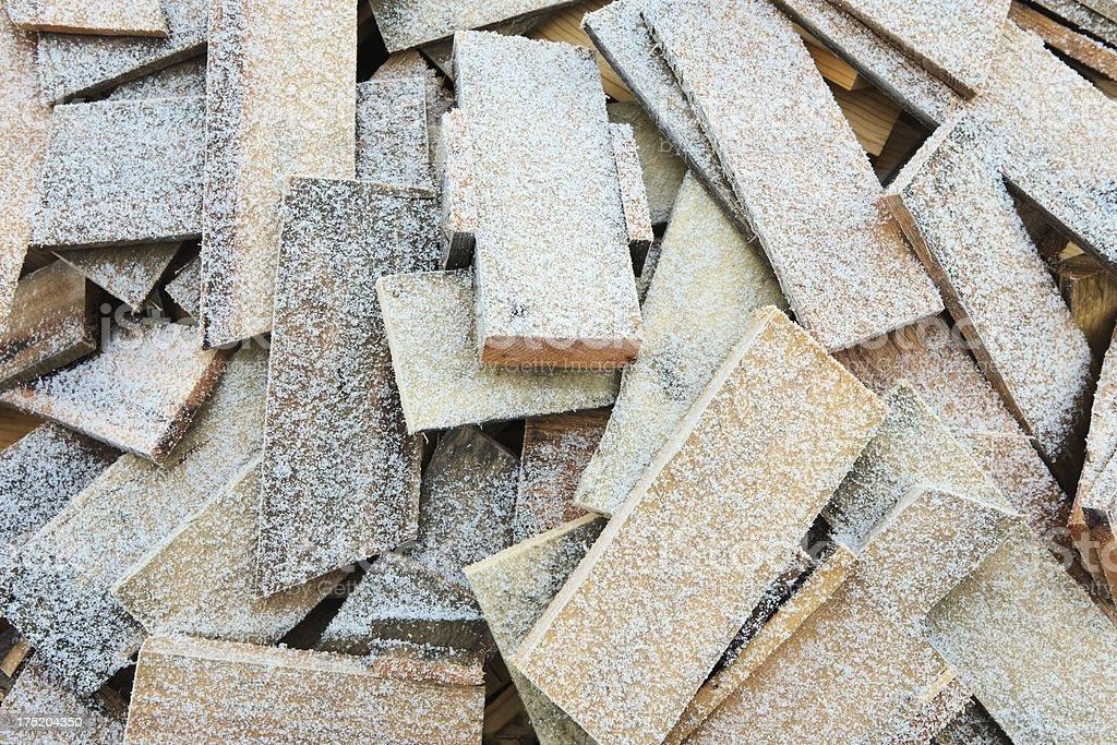 Wood Pile Snowflakes royalty-free stock photo