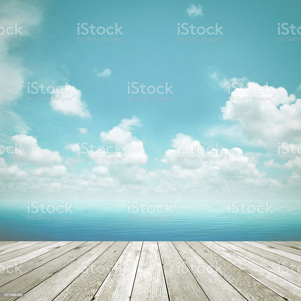 Wood plank on blue sea & sky background stock photo