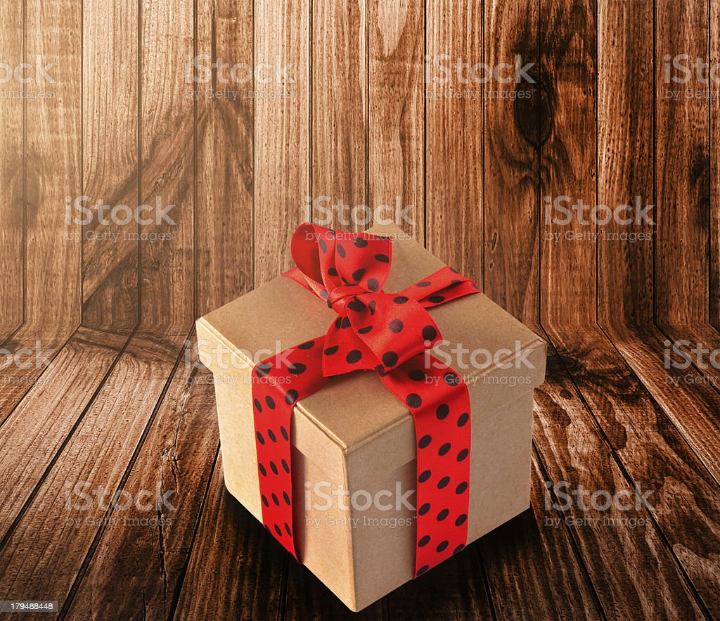Wood plank tablet with a gift royalty-free stock photo
