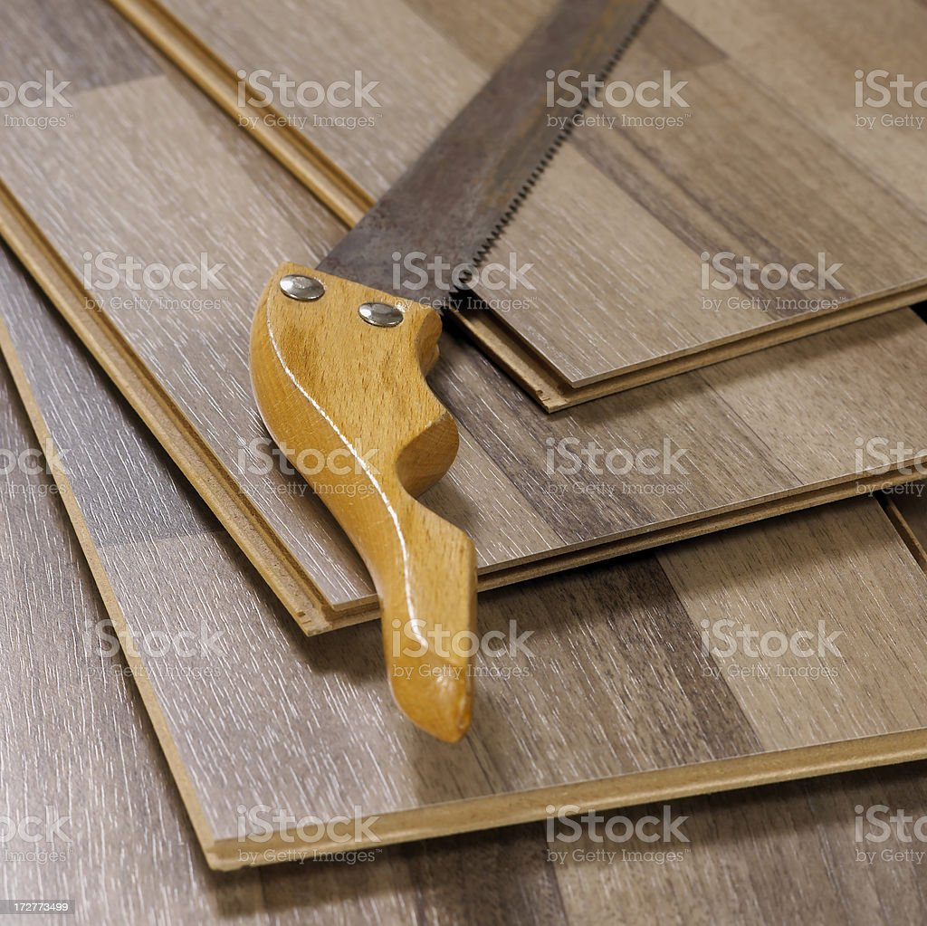 Wood planks and saw royalty-free stock photo