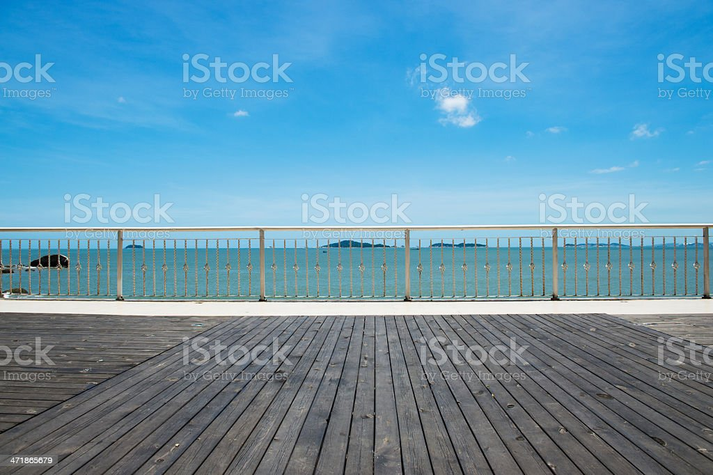 wood platform beside the sea stock photo