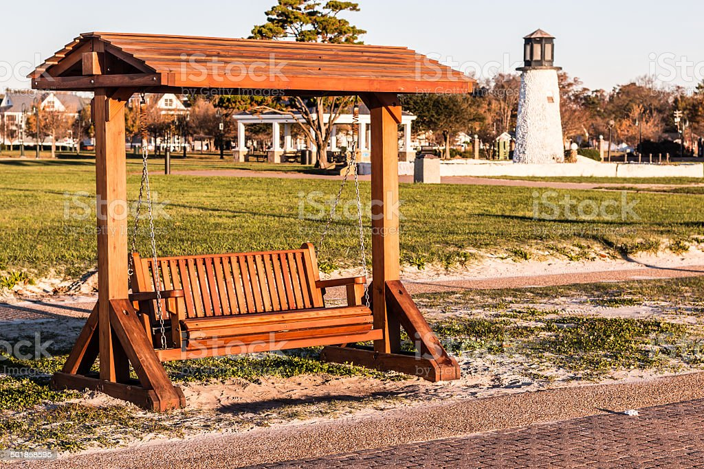 Wood Porch Swing at Buckroe Beach in Hampton, VA stock photo