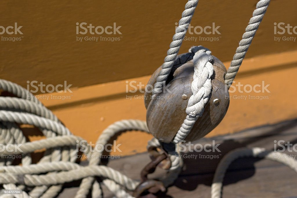 Wood Pulley System and rope royalty-free stock photo