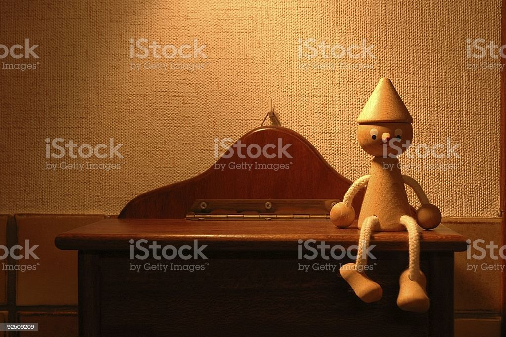 Wood pupet sitting royalty-free stock photo
