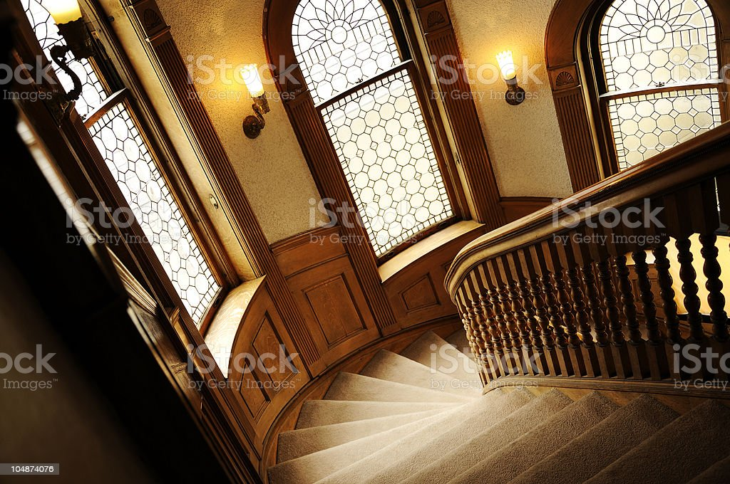 Wood Railed Spiral Stairs in Historic Home royalty-free stock photo