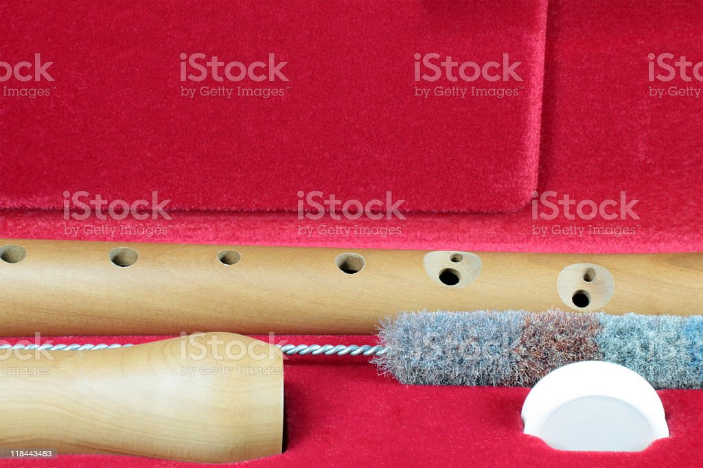 wood recorder in red case stock photo