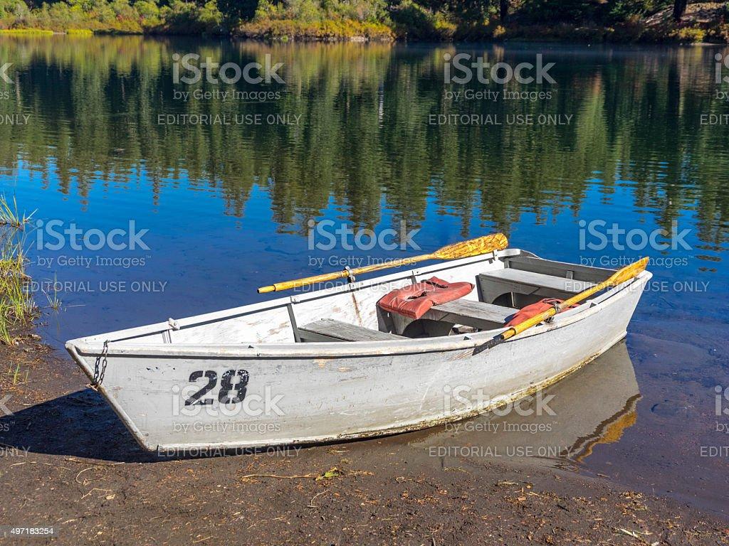 Wood Rowboat Clear Lake Oregon Tree Boat Reflections stock photo