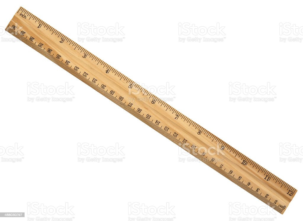 wood ruler isolated over a white background stock photo