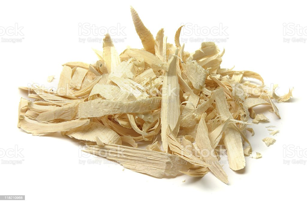 Wood shavings in a pile isolated on white royalty-free stock photo