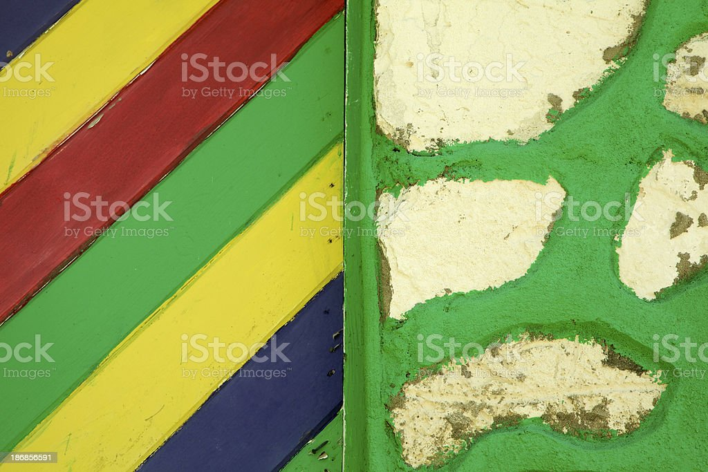 Wood Siding Next To Green Grouted Stone, Vibrant Paint royalty-free stock photo