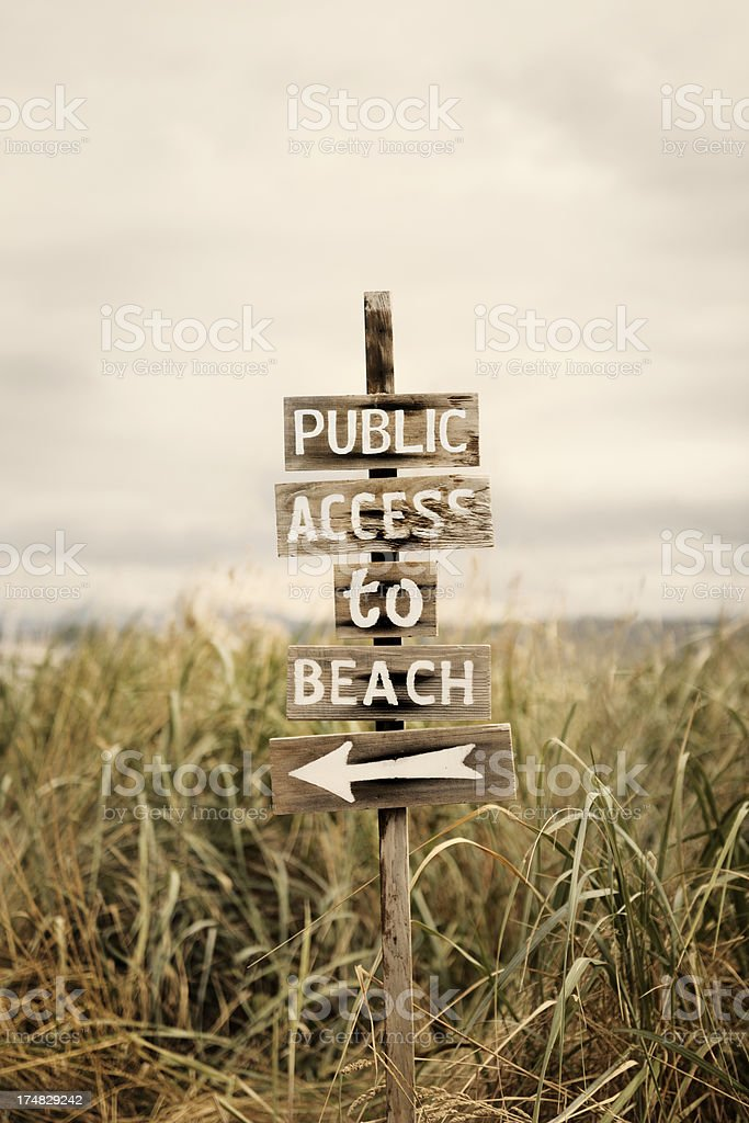 Wood sign at the beach stock photo